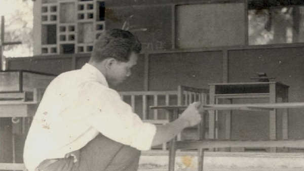 Hamid Tukang Kayu Rengit 1960s Working on Table